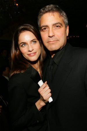 George Clooney got close to Amanda Peet at the National Board of Review in NYC in January 2006.