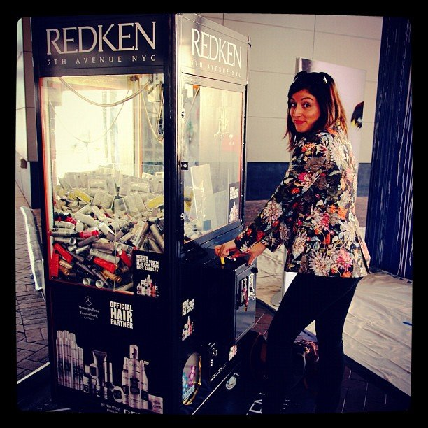 Sarah's not really into gaming, but she loved the Redken skill test machines on site.