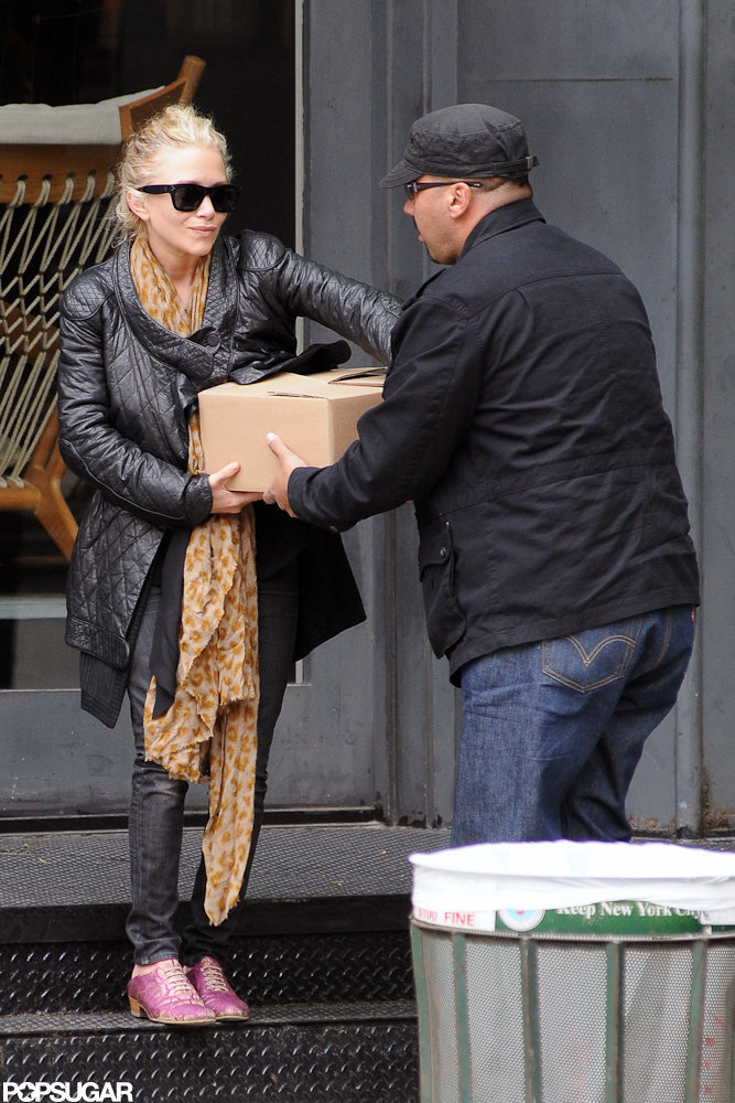 Mary-Kate Olsen was helped with a box she carried out of a store on a shopping trip in NYC.