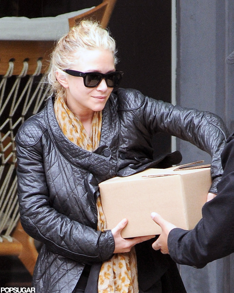 Mary-Kate Olsen was helped with a heavy box leaving a store in NYC.
