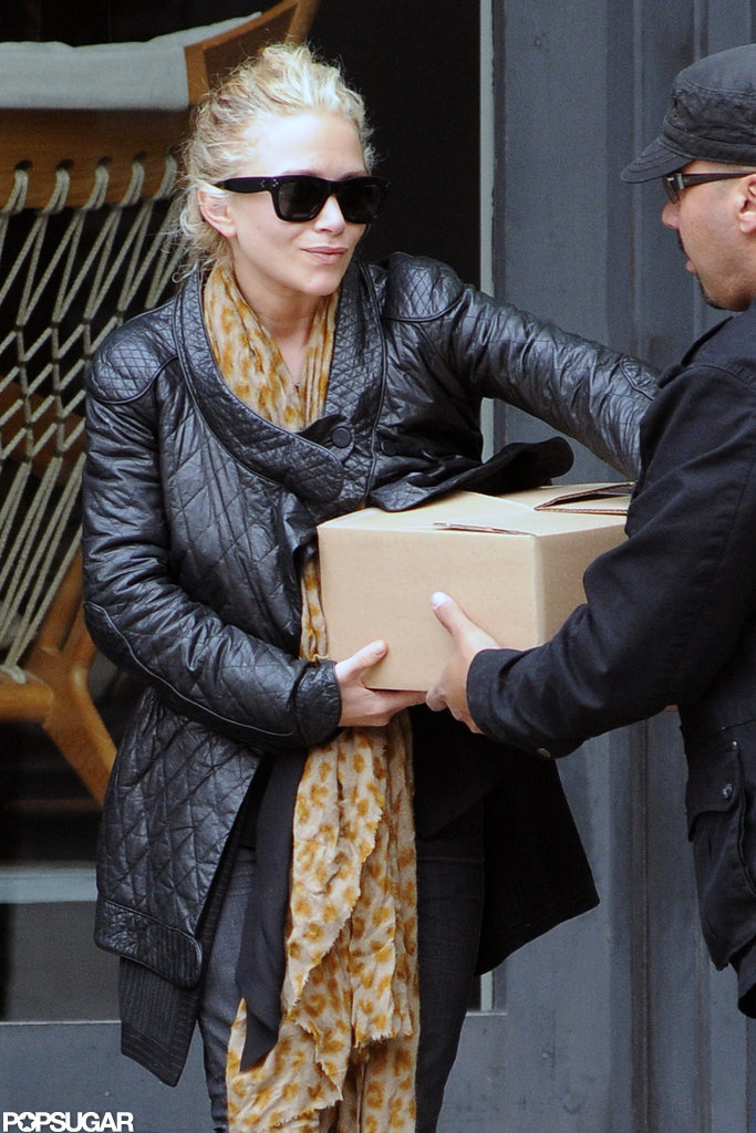 Mary-Kate Olsen got help carrying a heavy box out of a store in NYC.