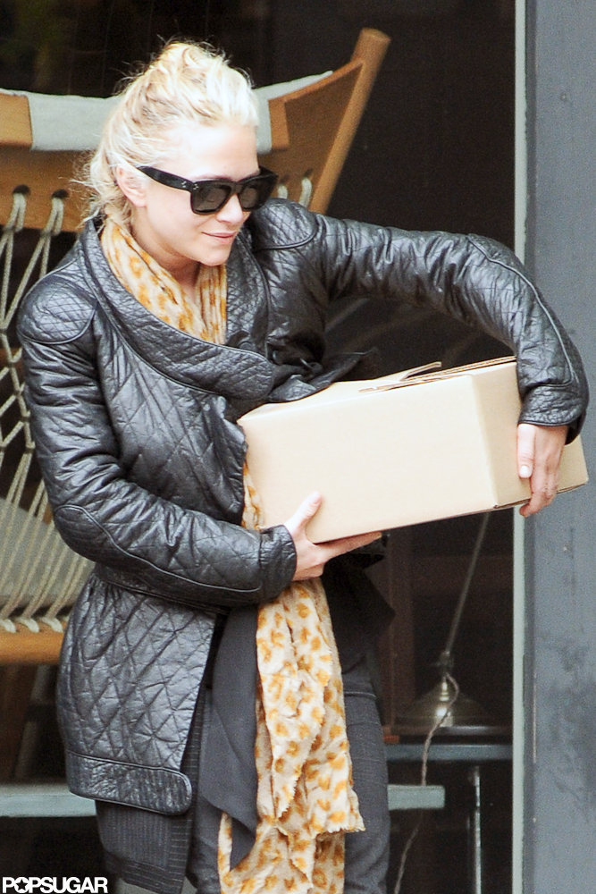 Mary-Kate Olsen purchased something while out shopping in NYC.