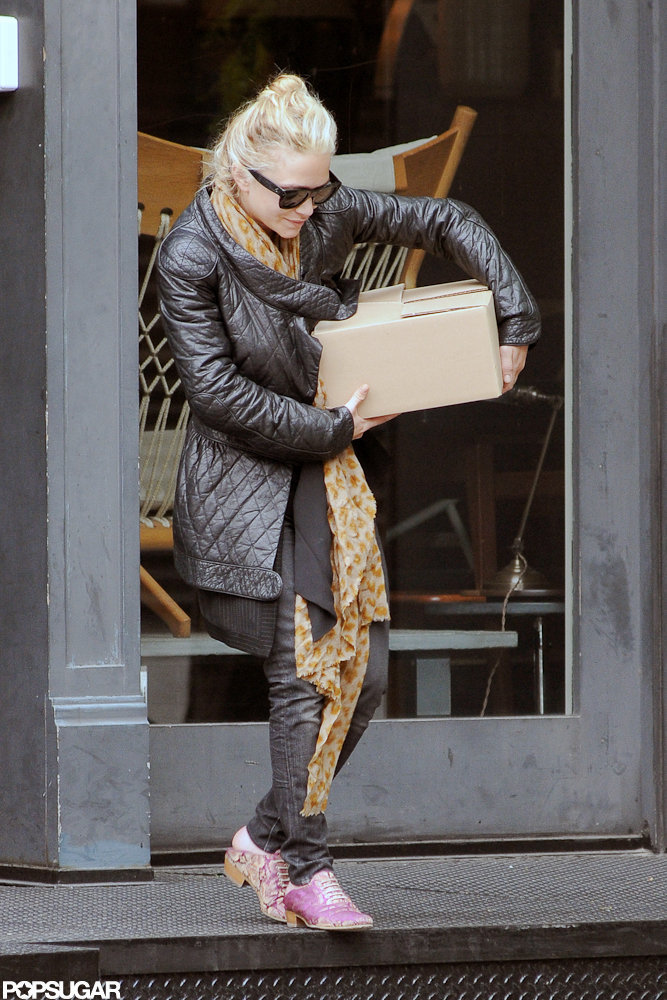 Mary-Kate Olsen bought something while shopping in NYC.