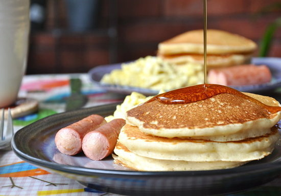 Sausages, scrambled eggs and old fashioned fluffy pancakes
