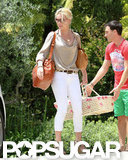 Katherine Heigl wore white pants and wedges to a friend's house accompanied by her newly adopted daughter in LA.