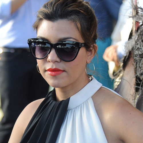 A Pregnant Kourtney Kardashian Wearing Orange Lipstick