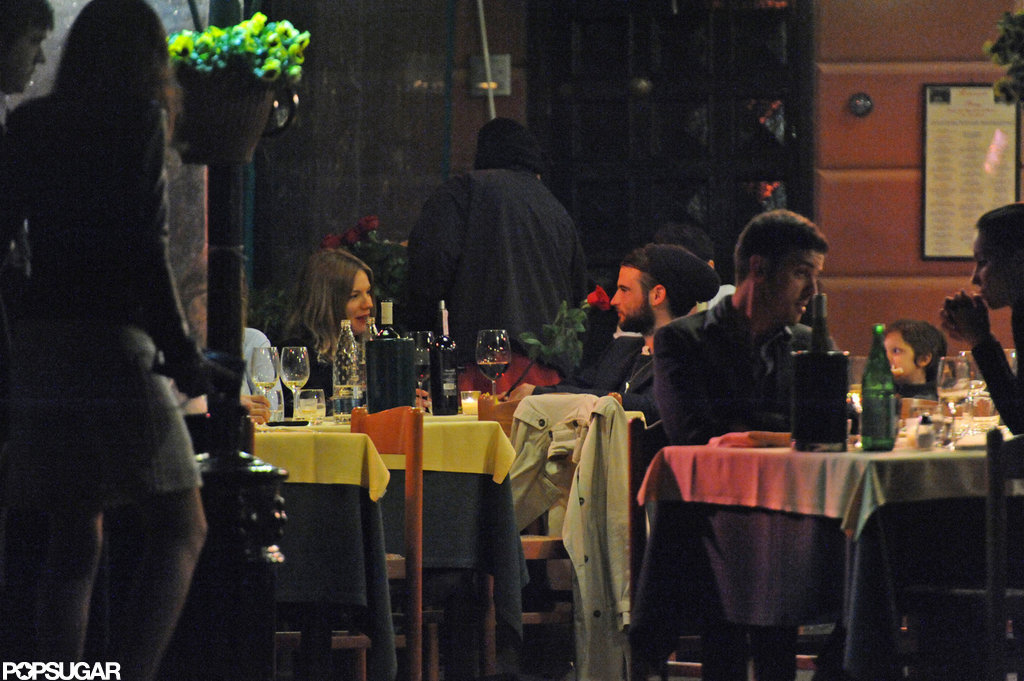 Sienna Miller and Tom Sturridge sat outside for a dinner date at a restaurant in Italy.