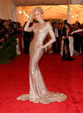 Karolina Kurkova wore a headpiece and dress by Rachel Zoe for the Met Gala.