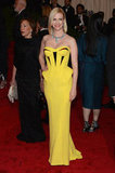 January Jones Rocks Bright Yellow Versace to the Met Gala
