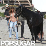 Gisele Bundchen wore a bikini at a shoot with a horse.
