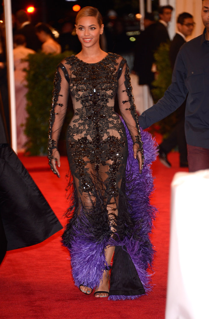 Beyoncé Knowles carried her purple train upon her arrival.