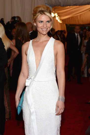 Claire Danes posed at the Met Gala in NYC wearing an embroidered J. Mendel gown.