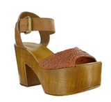 We love the cognac-colored heel on these platforms, and you can't beat the price.  Mia Shoes Weaver Platform Sandals ($79)