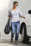 Halle Berry showed off a cool way to wear a superslouchy boyfriend jean — opt for slick loafers and a cozy, laid-back tee to complete the casual look.