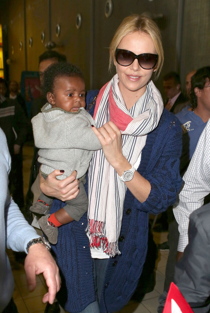 Charlize Theron held on tight to baby Jackson while arriving at a Paris airport in May 2012.