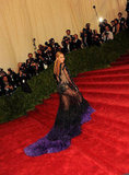 Beyoncé Knowles climbed the stairs at the Met Ball with her Givenchy gown's train following behind.