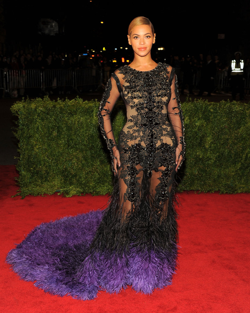 Beyoncé Knowles wore a sheer Givenchy number with a feathered train for the Met Gala.