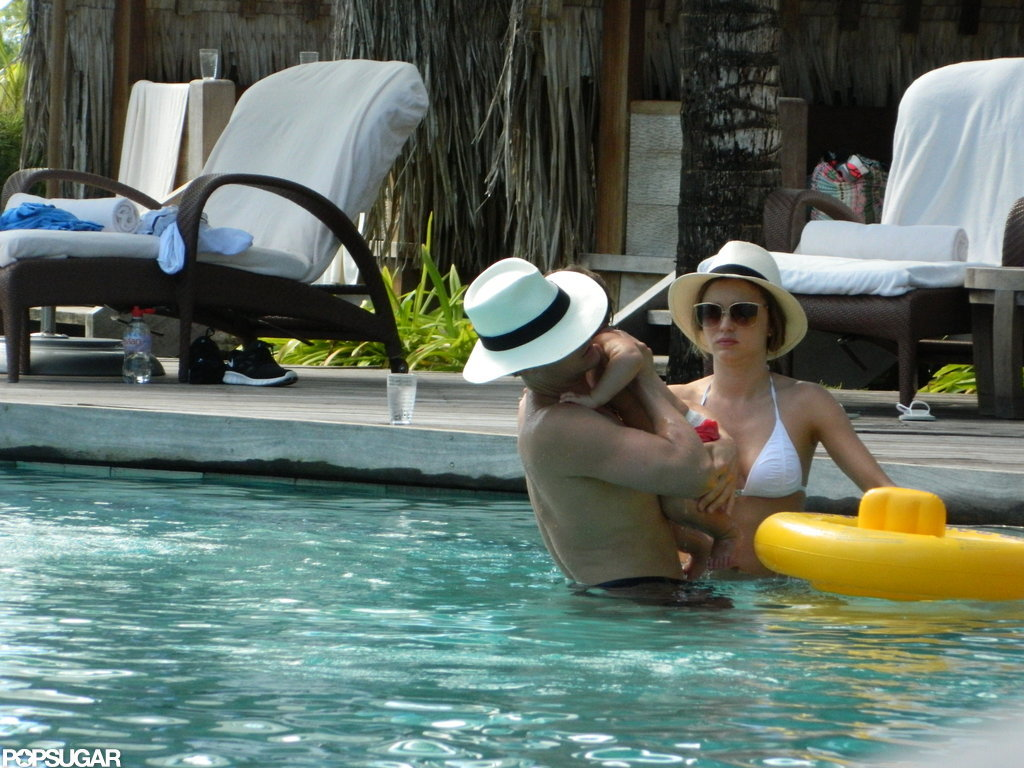 Orlando Bloom and Miranda Kerr played with Flynn in the hotel pool.