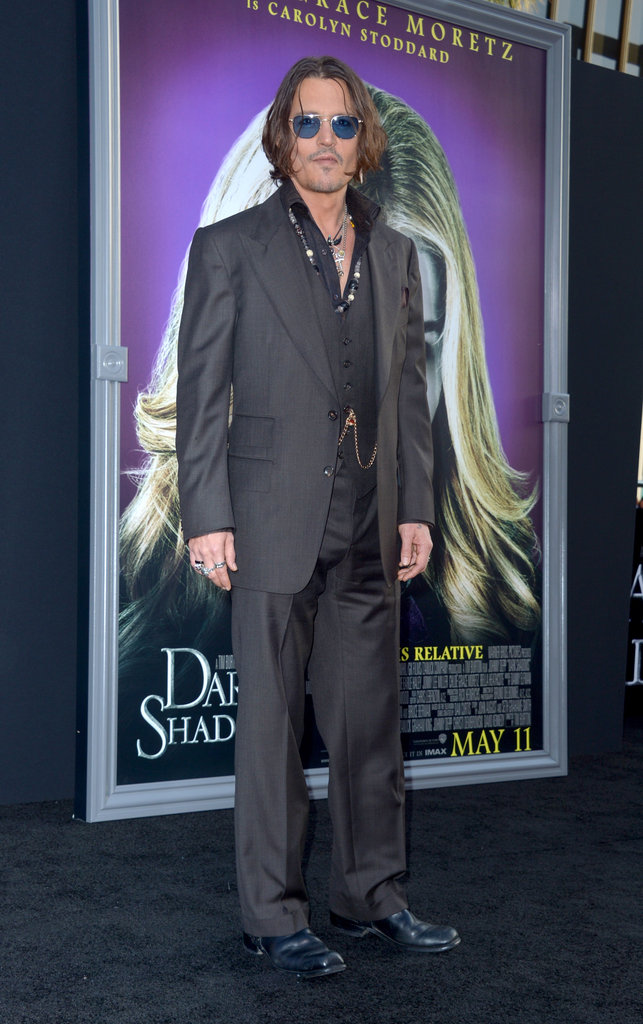 Johnny Depp stood on the black carpet at the Dark Shadows premiere in LA.