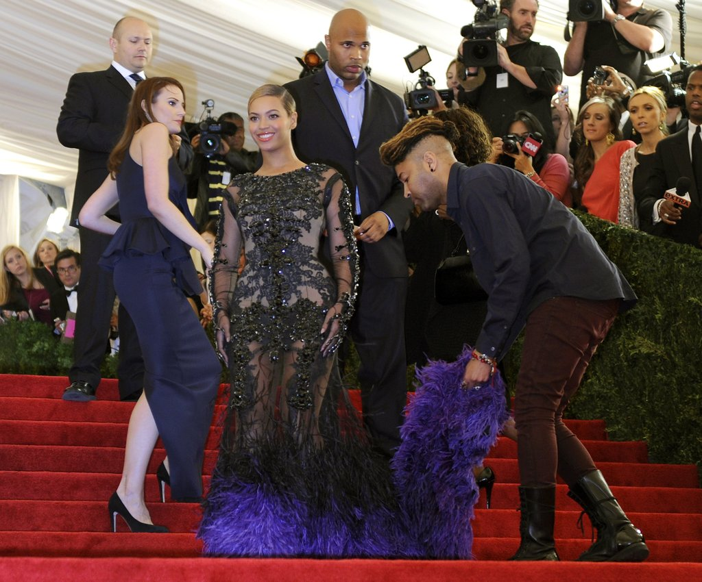 Beyoncé Knowles had plenty of of help getting her gorgeous Givenchy gown ready for photographers.
