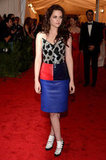 Kristen Stewart wore a beaded leather Balenciaga dress to the Met Ball in NYC.