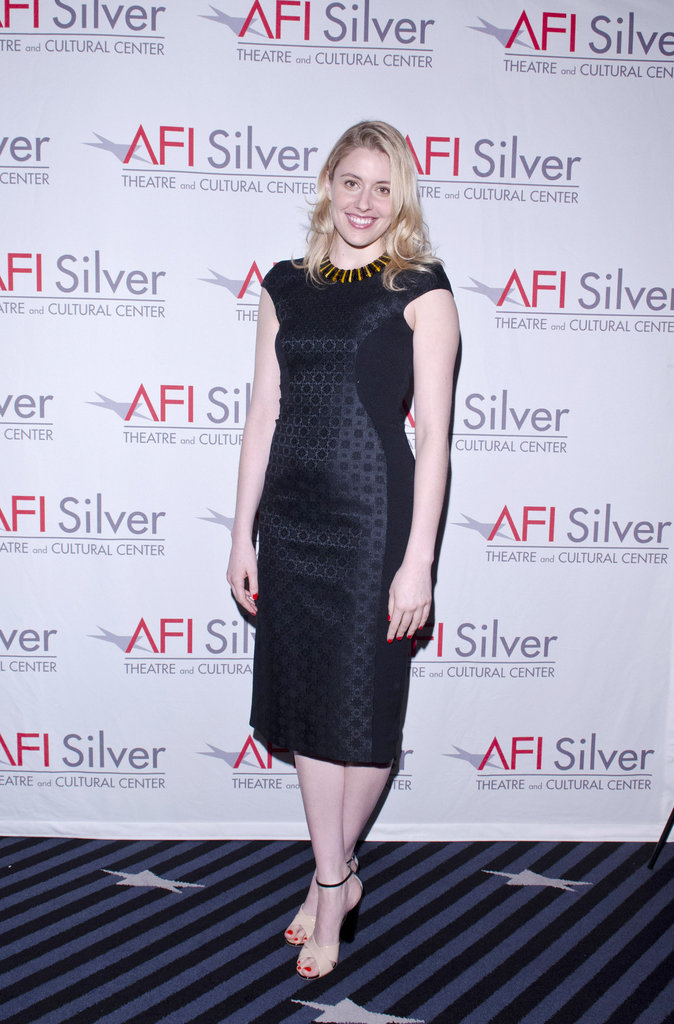 At a Damsels in Distress screening, Greta opted for a black brocade sheath dress, finished off with a statement necklace and ankle-strap, two-tone sandals.  6855762