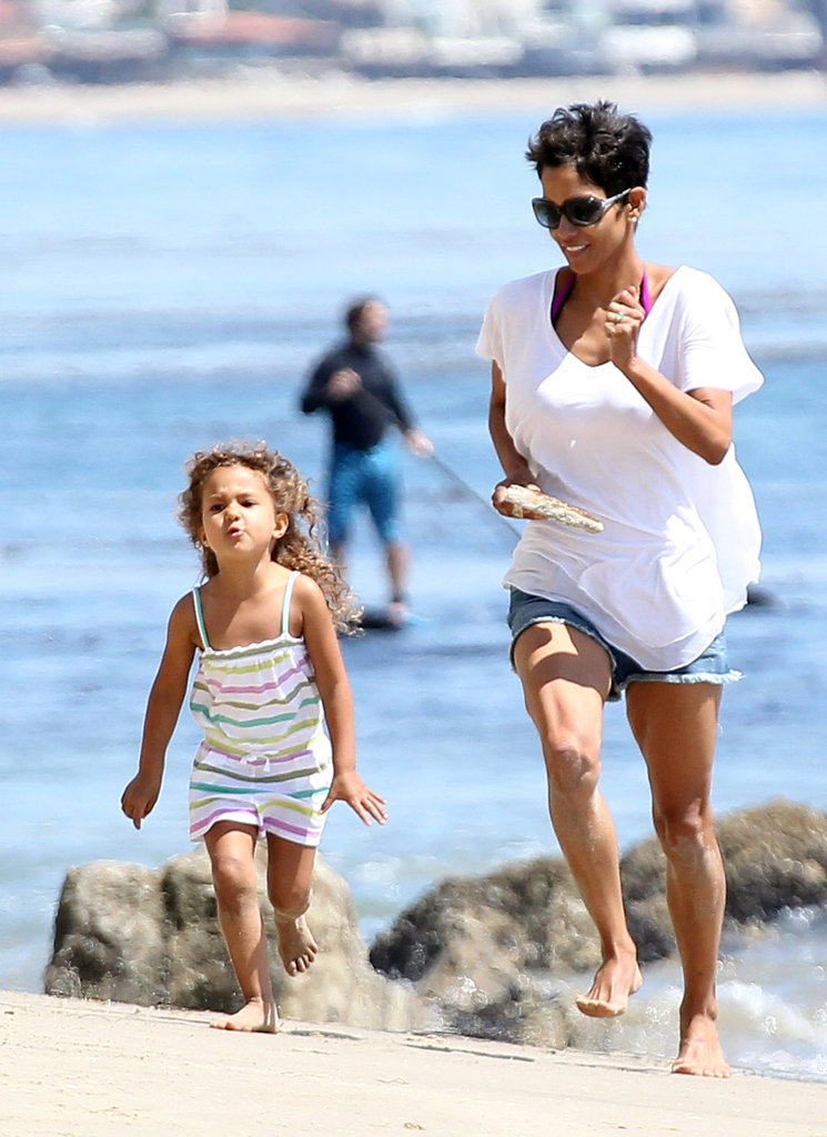 Halle Berry and daughter Nahla Aubry raced each other through the sand during a beach day in LA in April 2012.