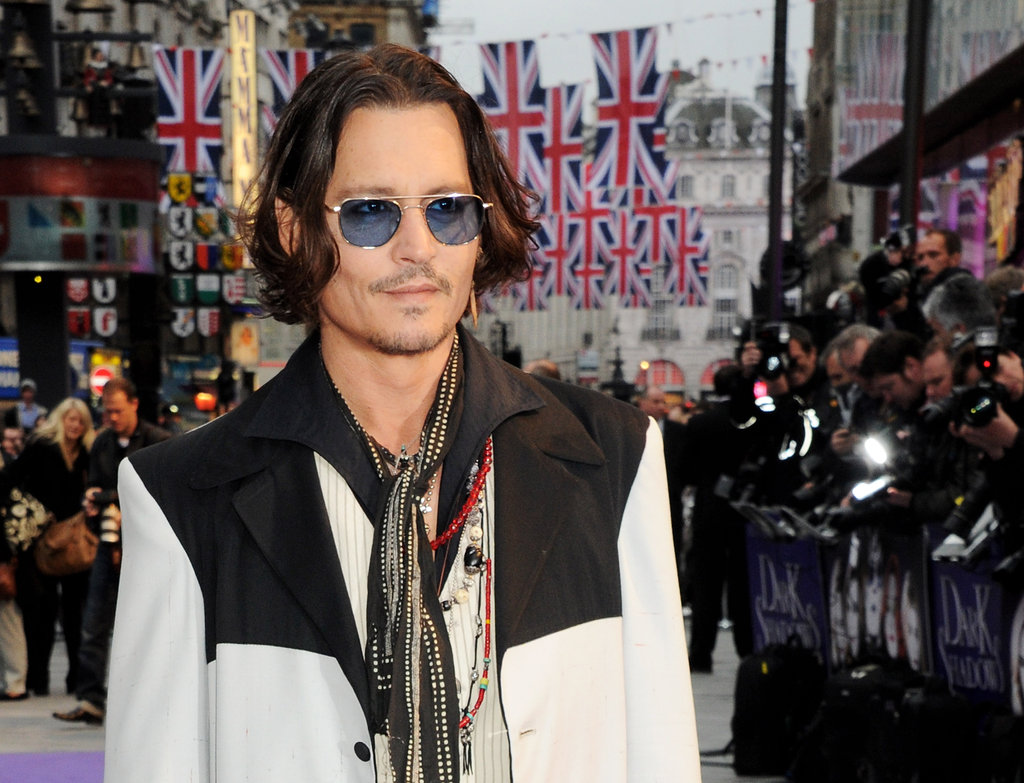 Johnny Depp stood in the Empire Leicester Square while fans took photos.