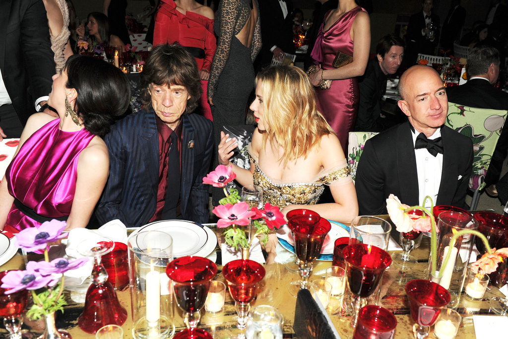 Scarlett Johansson caught a minute with Mick Jagger, who was seated next to girlfriend L'Wren Scott. Amazon's Jeff Bezos was also on hand. Billy Farrell/BFAnyc.com
