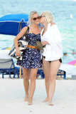 Julianne Hough got a sweet kiss on the cheek from her mother, Marriann Nelson, during a casual July 2011 stroll on the beach in Miami.