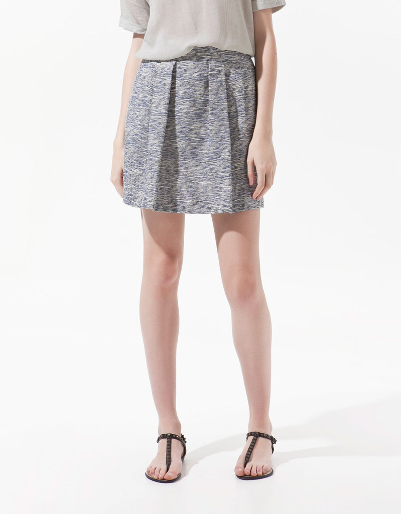 This little tweed skirt looks just as great with flats as it does with heels. We'd add a silky white button-down to give it a fresh seasonal touch.  Zara Front Pleat Skirt ($50)
