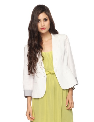 Transition your office attire right into the season with a white blazer to pair over practically anything.  Forever 21 Pinstripe Cuff Blazer ($25)