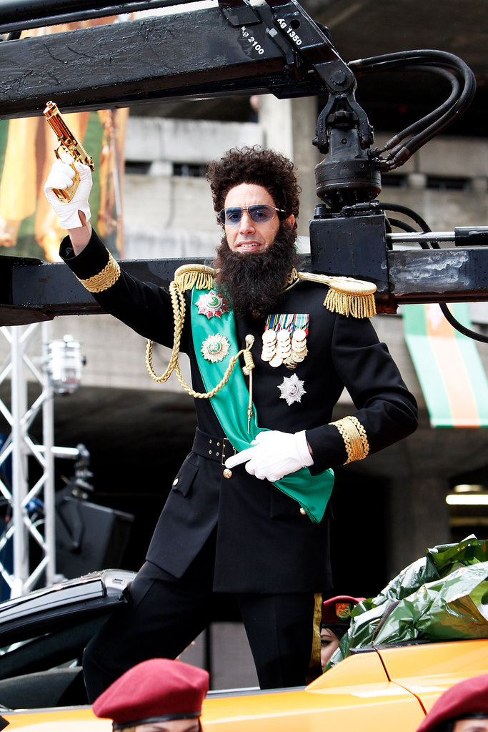 Sacha Baron Cohen posed with his fake gold gun at the event.
