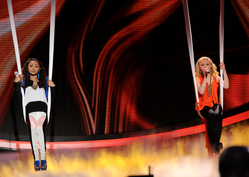 Hollie Cavanagh and Jessica Sanchez hovered over the stage on silks.