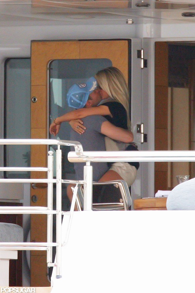Ryan Seacrest and Julianne Hough embraced on a yacht off the coast of Italy in July 2010.
