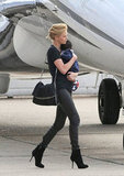 Charlize Theron boarded the plane with Jackson in her arms.