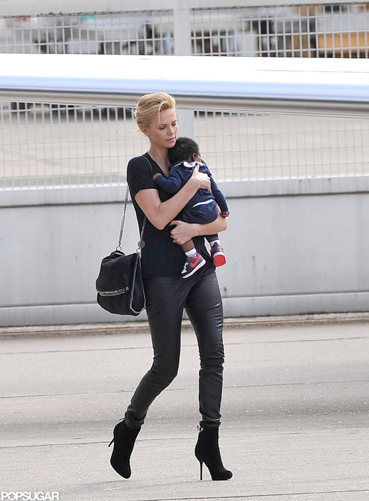 Baby Jackson Theron kept his toes warm in miniature Nike sneakers.