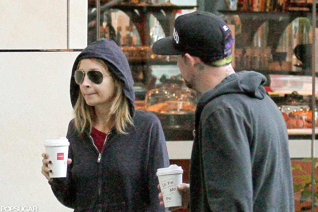 Nicole Richie wore a hooded sweatshirt for a coffee run with husband Joel Madden in Sydney.