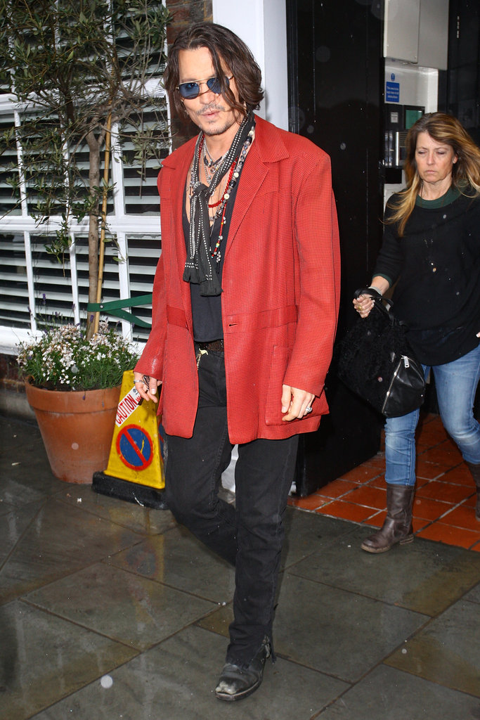 Johnny Depp stepped out in London today after denying a split from Vanessa Paradis yesterday.