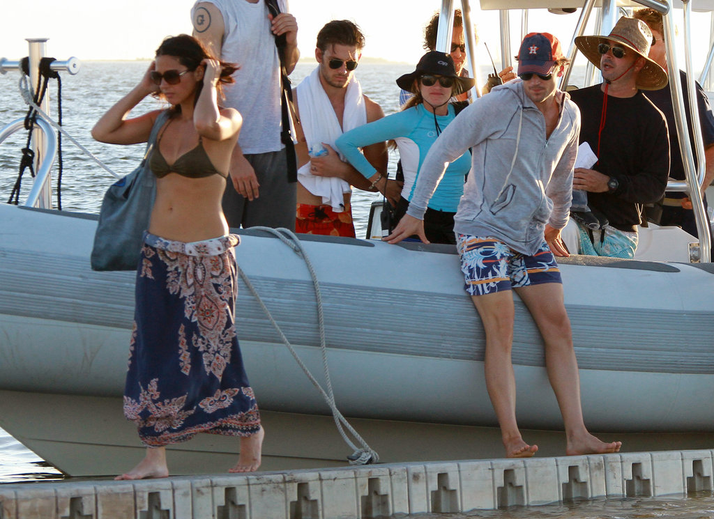 Matt Bomer and Olivia Munn hopped off a small sailing vessel after filming Magic Mike along the coast of Miami in October 2011.