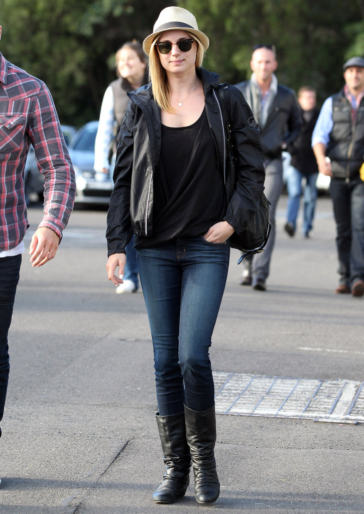 Emily VanCamp rocked her straw hat with a black tee and jacket, and skinny jeans tucked into black boots.