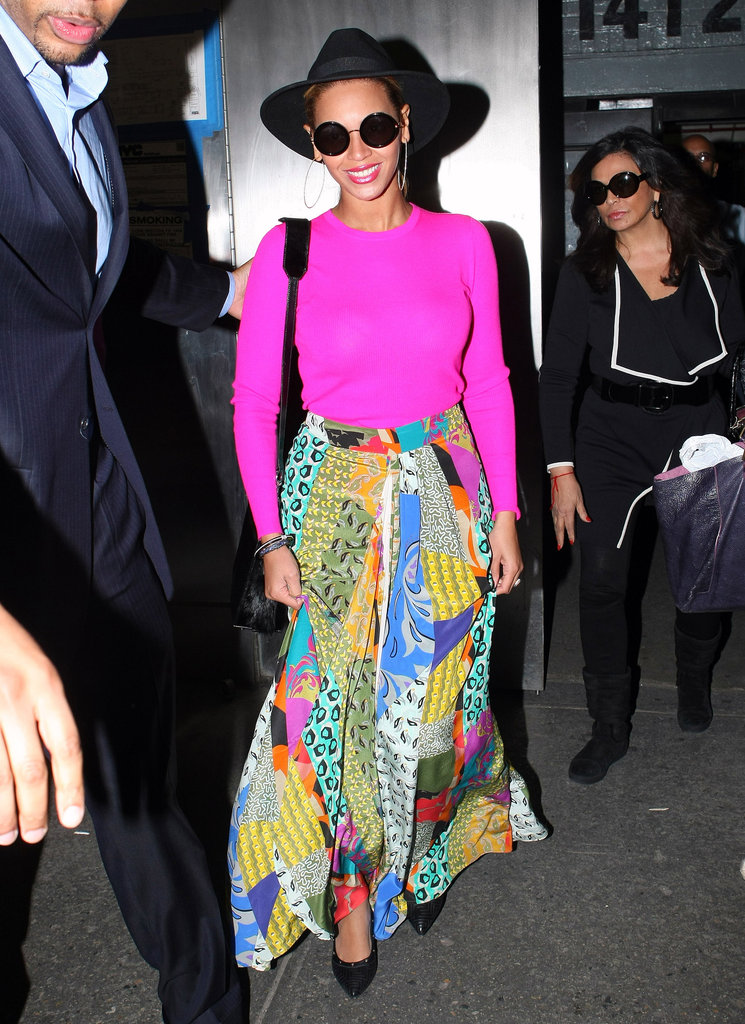 Nobody wears a hat quite like Beyoncé — the superstar wore her black felt fedora with a hot pink top and colorful printed Etro max skirt.