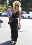 Rachel Zoe stayed chic while toting baby Skyler in a black maxi dress cinched at the waist and topped with a wide-brimmed straw hat. 6863978