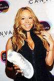 Mariah Carey posed with an artful sneaker at the Project Canvas Exhibition & Art Gala in NYC.