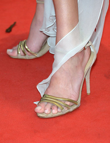 A closer look at Erin's gold strappy heels.