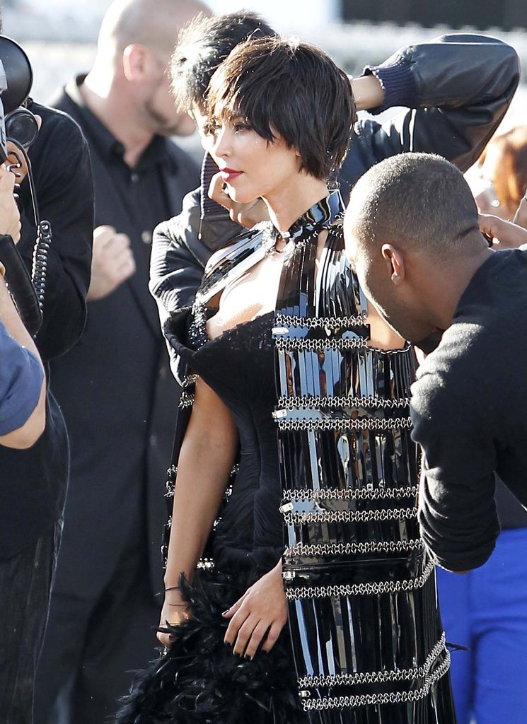Kim Kardashian wore a low-cut corset with a cape for the photo shoot.