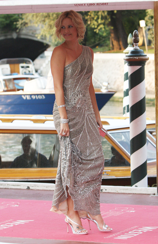 Charlize Theron exited a boat in a stunning silver dress while attending the Venice Film Festival in 2008.