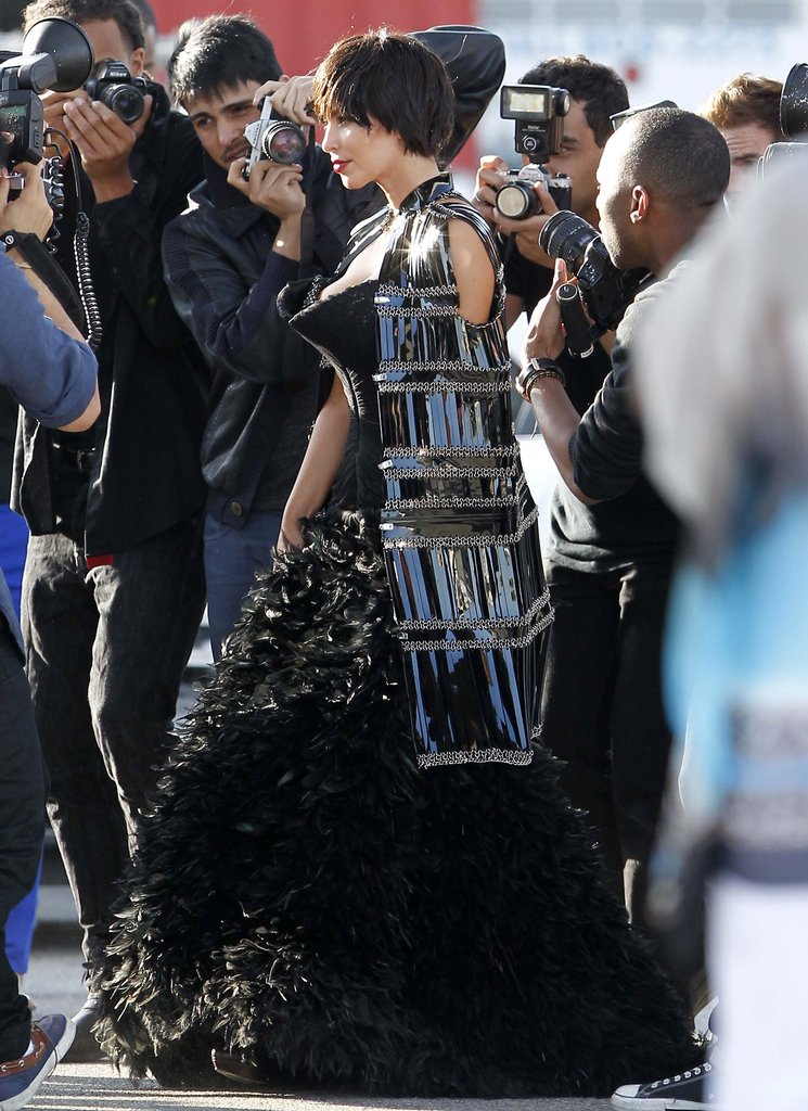Kim Kardashian posed while surrounded by photographers.
