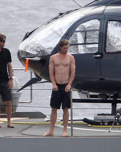 Chris Hemsworth showed off his abs while having fun on a yacht with wife Elsa Pataky and Matt Damon in St. Barts in January 2012.