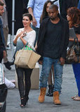 Kim Kardashian walked with her boyfriend Kanye West.